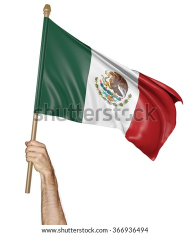 Hand proudly waving the national flag of Mexico - stock photo