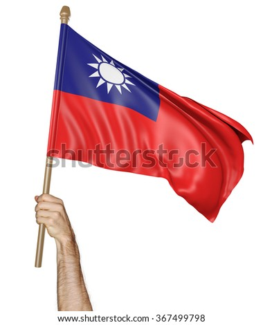 Hand proudly waving the national flag of Taiwan - stock photo