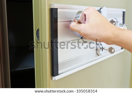 hand pull opening green steel bank safe - stock photo