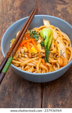 hand pulled stretched Chinese ramen noodles on a bowl with chopstick - stock photo