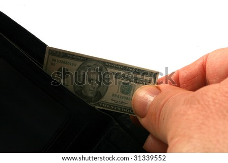 hand pulls miniature money out of a wallet representing the world financial crisis isolated on white - stock photo
