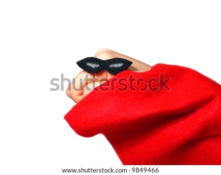 Hand puppet dressed in a super hero costume over a white background