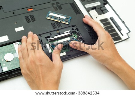 Hand push RAM is changing for Laptop computer,Repair computer concept. - stock photo