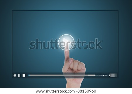 hand push start button on touch screen to run video clip - stock photo