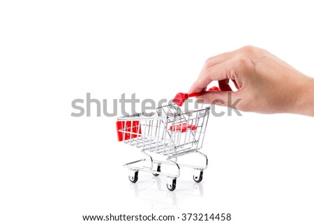 hand pushing a red shopping cart isolated on a white background
