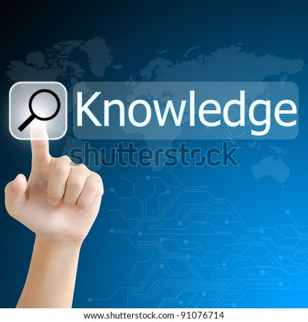 hand pushing a search button to find knowledge word on a touch screen interface