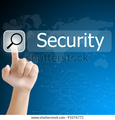 hand pushing a search button to find security word on a touch screen interface - stock photo