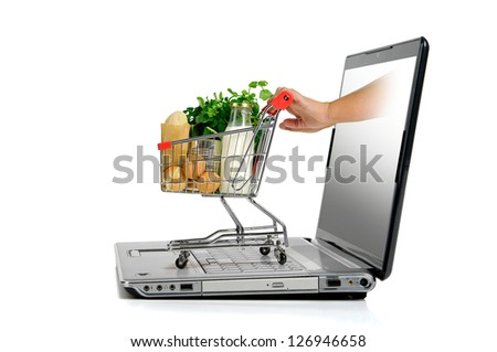 Hand pushing a small shopping cart from  laptop screen isolated in white - stock photo
