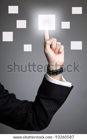 hand pushing a touchscreen button