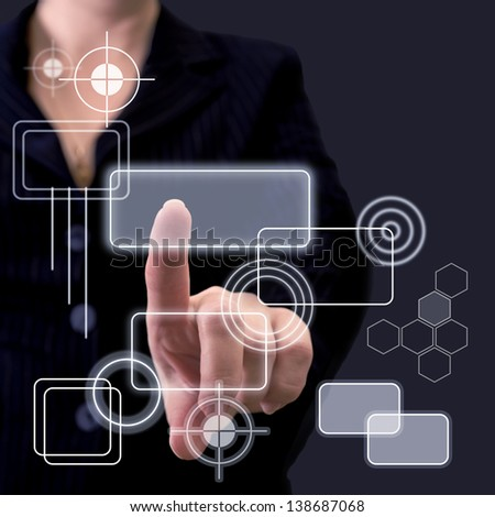 Hand pushing button on a touch screen - stock photo