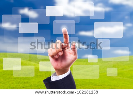 HAND pushing button on blue sky background - stock photo