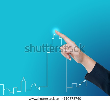 Hand pushing city button on a touch screen interface - stock photo