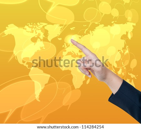 Hand pushing comment button on a touch screen interface - stock photo