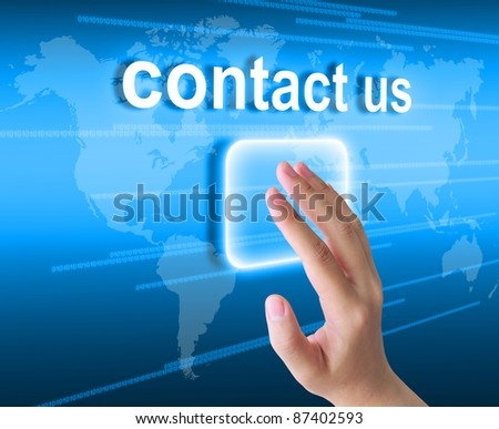 hand pushing contact us button on a touch screen interface - stock photo