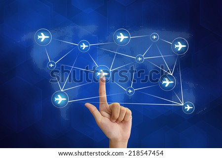 hand pushing flight booking networking with blue background - stock photo