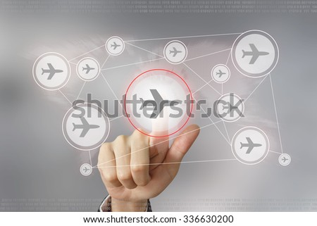 hand pushing flight traveling button with global networking concept - stock photo