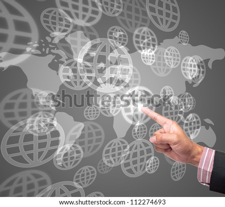 Hand pushing global button on a touch screen interface