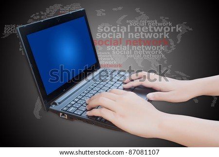 Hand pushing laptop keyboard with social network word.