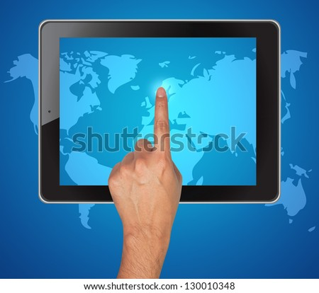 Hand pushing map of tablet on a touch screen - stock photo
