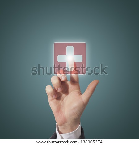 Hand pushing medical button - stock photo