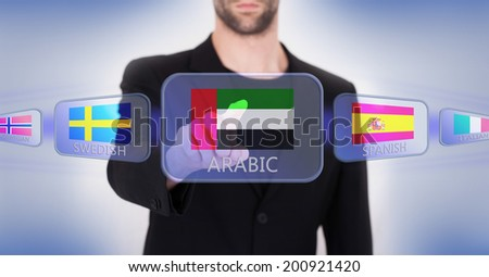 Hand pushing on a touch screen interface, choosing language or country, United Arab Emirates - stock photo