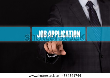 Hand pushing on a touch screen interface-JOB APPLICATION button - stock photo