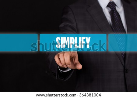 Hand pushing on a touch screen interface-SIMPLIFY button - stock photo