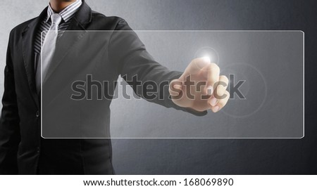 hand pushing on  touch screen interface  - stock photo