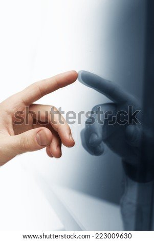 hand pushing on touch screen interface, close up - stock photo