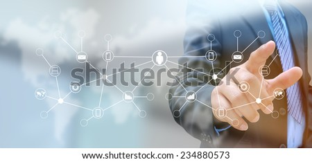 hand pushing social network button on a touch screen interface