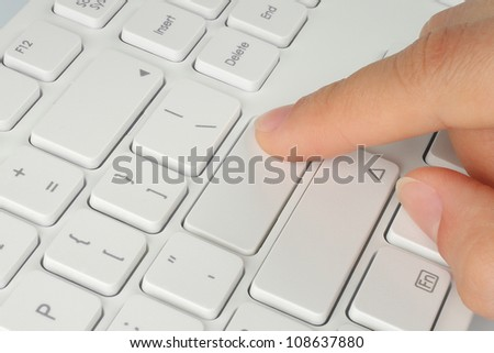 Hand pushing the button of keyboard