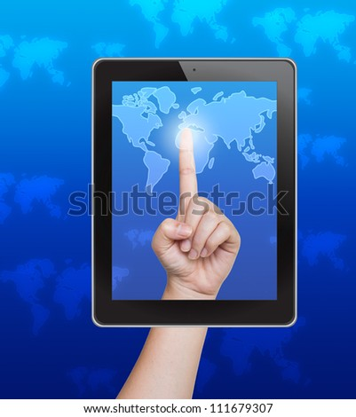 Hand pushing world map button of tablet on a touch screen