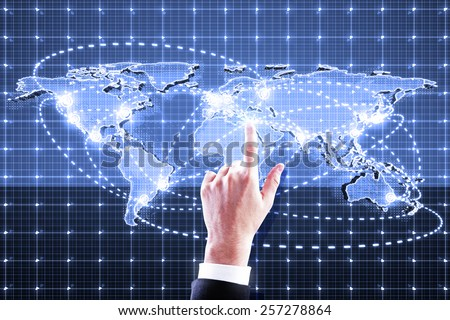 hand pushing world map interface on blue background - stock photo