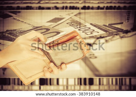 hand put coin from purse with blur image of graph stock market