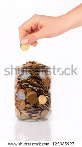 hand put coin jar with coins isolated on white