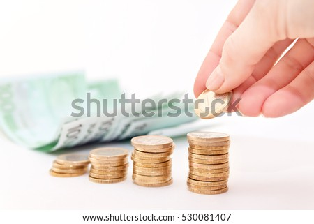 Hand put coin to money , euro notes on background. Business idea
