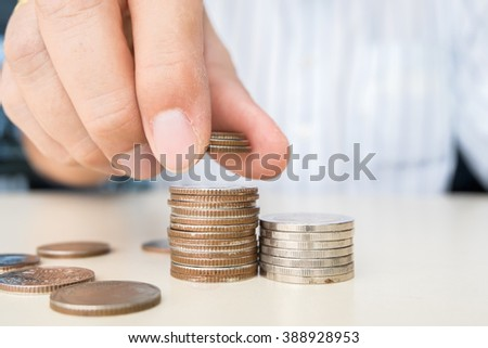 Hand put coins to stack of coins, business ideas