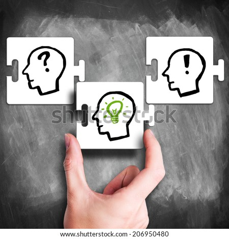 hand puts the missing piece of the idea puzzle  - stock photo