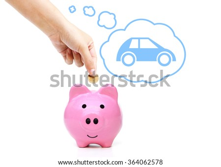 hand putting a coin into a pink piggy bank thinking of buying a new car - saving money for future concept - stock photo