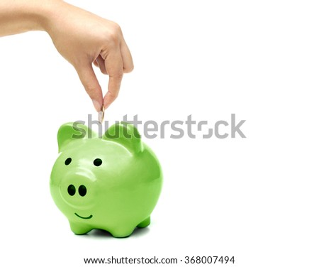 hand putting a golden coin to a green piggy bank - people do green saving