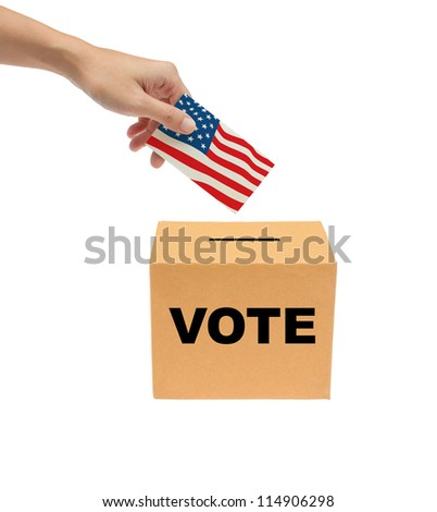 Hand putting a voting ballot into the box isolated on white background. - stock photo