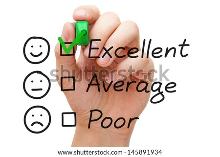 Hand putting check mark with green marker on excellent customer service evaluation form. - stock photo