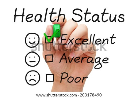 Hand putting check mark with green marker on excellent in Health Status evaluation form. - stock photo