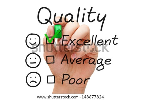 Hand putting check mark with green marker on excellent quality evaluation form. - stock photo