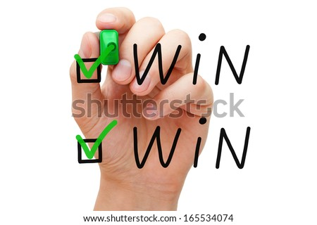Hand putting check mark with green marker on Win Win. - stock photo