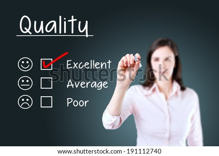 Hand putting check mark with red marker on excellent quality evaluation form.  - stock photo