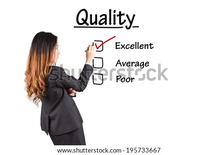 Hand putting check mark with red marker on excellent quality evaluation form.