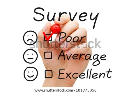 Hand putting check mark with red marker on poor survey evaluation form. - stock photo