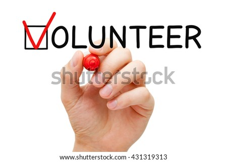Hand putting check mark with red marker on the tick box in Volunteer form. Volunteerism concept.