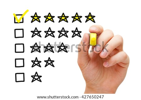 Hand putting check mark with yellow marker on five star rating. Customer satisfaction concept.